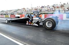 auto racing(0.0), stock car racing(0.0), formula racing(0.0), touring car(0.0), indycar series(0.0), formula one(0.0), formula one car(0.0), supercar(0.0), race car(1.0), automobile(1.0), racing(1.0), sport venue(1.0), vehicle(1.0), sports(1.0), race(1.0), automotive design(1.0), open-wheel car(1.0), motorsport(1.0), drag racing(1.0), race track(1.0), luxury vehicle(1.0), sports car(1.0),