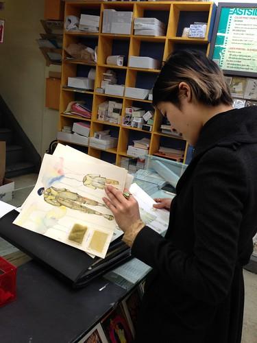 Fashion student, examining her portfolio, Manhattan