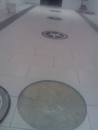 Commercial porcelain tile and star medallion inserts at Spa n nail salon
