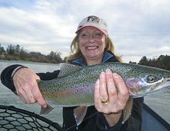 Anne is all smiles, great weather and a hefty Lower Sac Rainbow