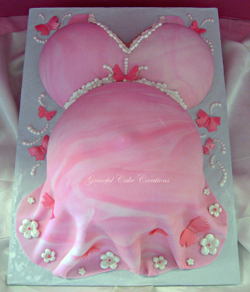 Pink baby bump baby shower cake with butterflies and flowers a photo