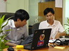 (left to right) Mr. Channa Ly, a Senior Software Developer and Mr. Chanmann Lim, a Technical Project Manager discuss the working flow of the Referral System.