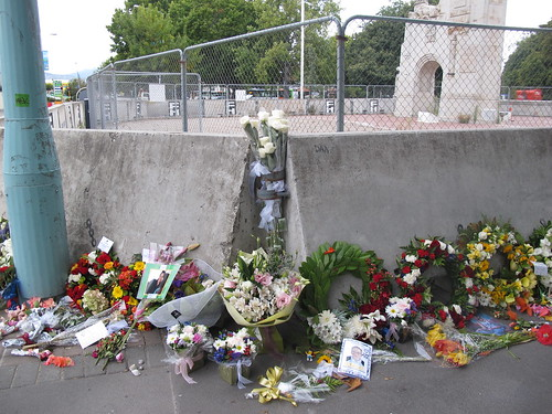 Bouquets and tributes by the Bridge of Remembrance