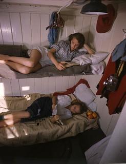 Young women reading aboard the shantyboat Lazy Bones