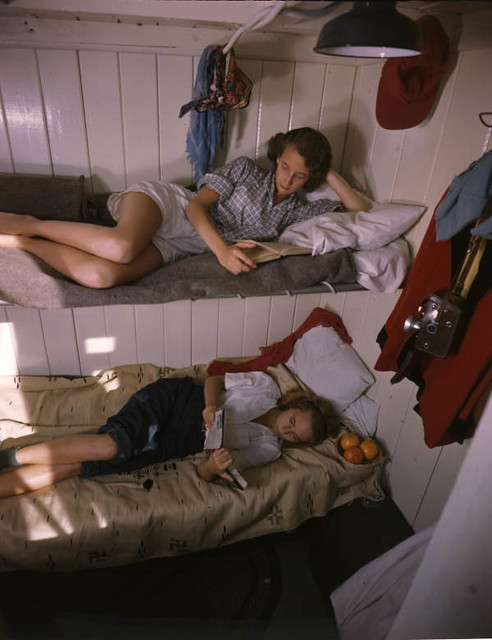 Young women reading aboard the shantyboat Lazy Bones from Flickr via Wylio