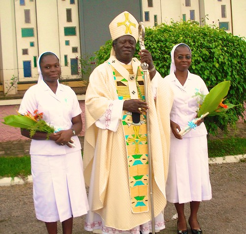 Irene Ballakpa SSL (left) and Benedicta Boakye-Yiadom SSL (right) with Archbishop Kwaku Mensah following their final vows ceremony at St Louis Chapel, Mbrom, Ghana