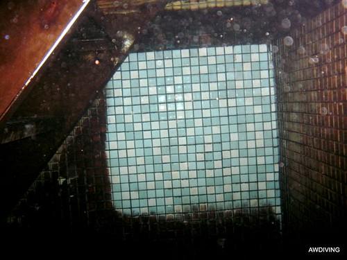 zwembad tegels reinigen