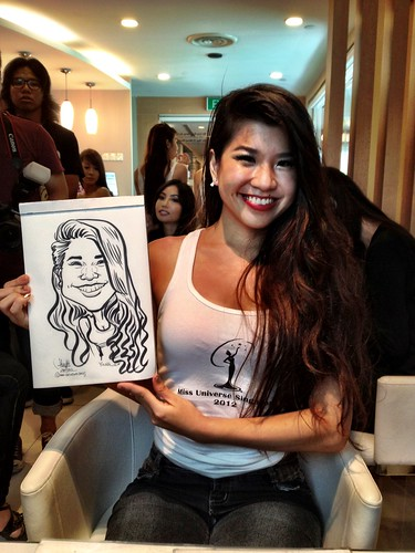 caricature live sketching for Orchard Scotts Dental for Miss Universe Singapore - 2