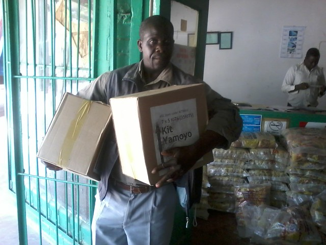 Alfred Siachoobe,  retailer in  buys Kit Yamoyos by the box full