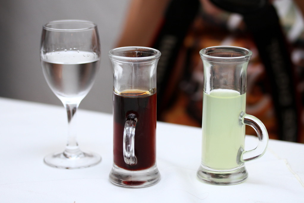 Etna Italian Restaurant & Pizzeria: Italian liqueurs. They are Limoncello (yellow), Amaro (red) and Grappa (colourless)