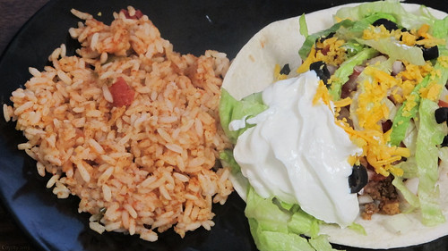 Soft taco and Spanish rice by Coyoty