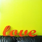 2/8 Something orange. #fmsphotoaday Our 'love' cutout came yesterday; cannot wait to get it up on the photo wall! #photowall #love #inspiration #family #photo #orange #wood