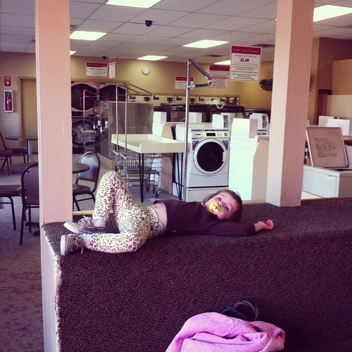 Lounging at the laundromat in my leopard pants and sequined shoes.