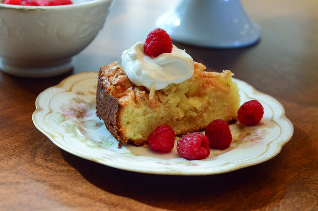 Almond Crunch Pound Cake served on a plate with raspberries.