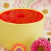 yellow ceramic jar with neon pink lid