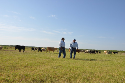Javier Mancha, right, visits with NRCS District Conservationist Serafin Aguirre about pasture conditions and grazing plans for his cattle.