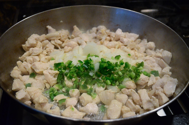 Onion and jalapeno is added to the chicken.