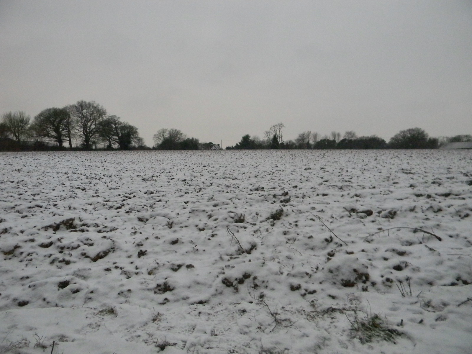 The way ahead Towards the cottage, across a ploughed, snowy field. Snodland to Sole Street
