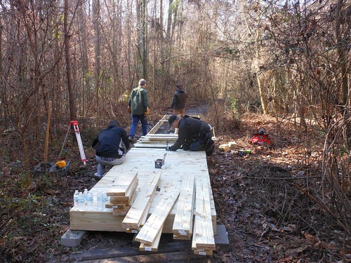 Volunteers work on 32 feet of a boardwalk through a forest area in southwest Atlanta as part of the Martin Luther King Jr. Day of Service. (US Forest Service photo)