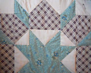 Swoon, hand quilting this star right now