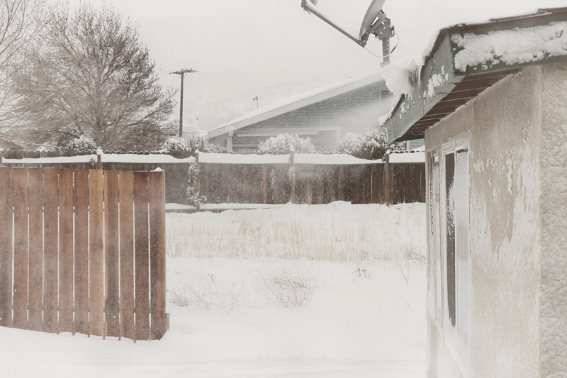 backyard-driveway-snow-fence-blowing-off-roof