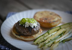 r.e. ~ posted a photo:	Home cooking using ingredients delivered from Blue Apron. Serrano Pepper & Goat Cheese Burgers with Zucchini Slaw. Very good. Thank you Blue Apron!