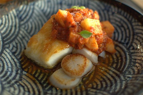 Chilean sea bass, roasted scallops, yucca & panca sauce