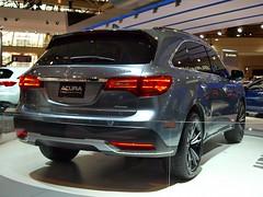executive car(0.0), saab 9-4x(0.0), infiniti qx70(0.0), automobile(1.0), automotive exterior(1.0), sport utility vehicle(1.0), wheel(1.0), vehicle(1.0), automotive design(1.0), auto show(1.0), mid-size car(1.0), bumper(1.0), land vehicle(1.0), luxury vehicle(1.0), acura(1.0),