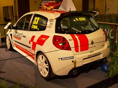 driving(0.0), rallying(0.0), renault clio v6 renault sport(0.0), family car(0.0), sedan(0.0), auto racing(1.0), automobile(1.0), automotive exterior(1.0), racing(1.0), vehicle(1.0), automotive design(1.0), motorsport(1.0), rallycross(1.0), auto show(1.0), subcompact car(1.0), city car(1.0), bumper(1.0), hot hatch(1.0), land vehicle(1.0),