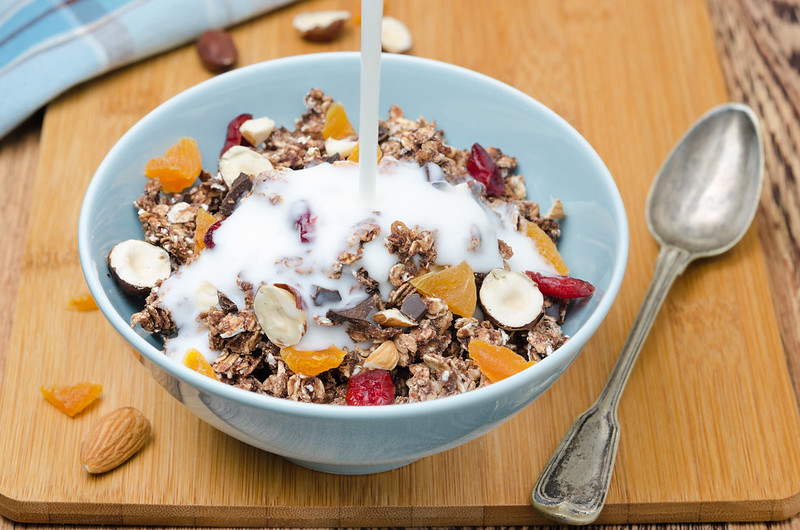 Chocolate granola with nuts and dried fruit and yogurt