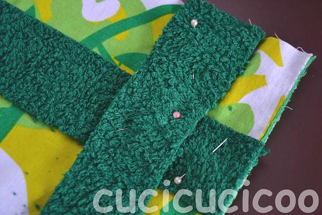 criss-crossing towel border pinned onto foot bath/locker room mats