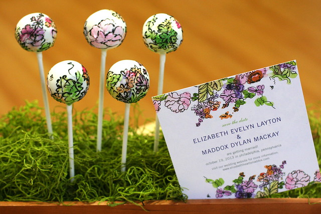 Watercolor Painted Cake Pops match these lovely Save The Dates from Wedding Paper Divas