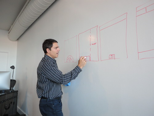 Mike Smith CEO of Transparent Inc arcs out ideas on the map board wall