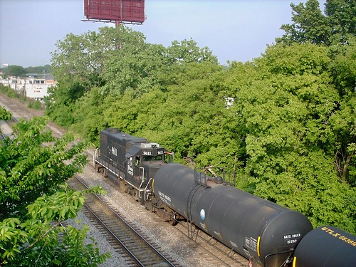 A former Illinois entral EMD roadswitcher shovig a cut of tank cars, at the CN Glen Yard.  Chicago Illinois.  May 007. by Eddie from Chicago