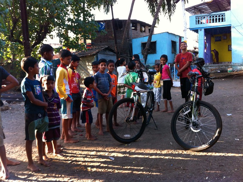 Village kids admire our cycles at Arnala