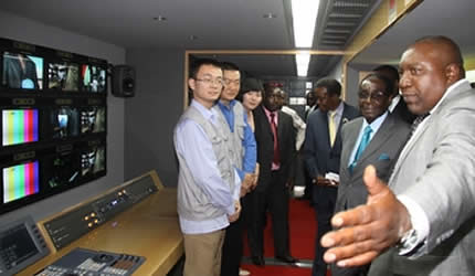 Republic of Zimbabwe President Robert Mugabe donates outside broadcast van from the People's Republic of China. China has been a long time ally of the Southern African state. by Pan-African News Wire File Photos