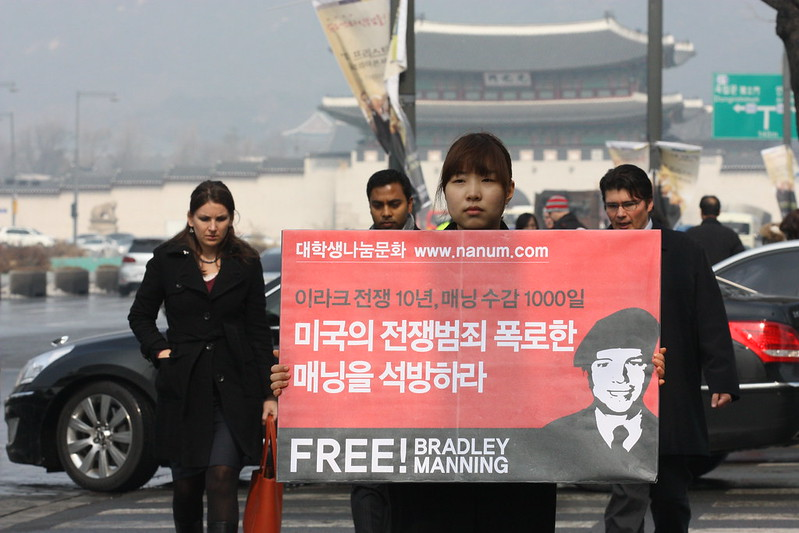 Jae-hyun Kim leads a protest in front of the U.S. embassy in Seoul, South Korea, on Feb. 23, 2013, calling for the release of Bradley Manning. Photo courtesy of Bradley Manning Support Network flickr.com/photos/savebradley