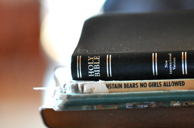 bible on stack of books