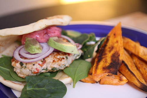 Turkey Burger with Spinach, Avocado, Onion, and Sour Cherry Mayonnaise on Naan with Sweet Potato Fries