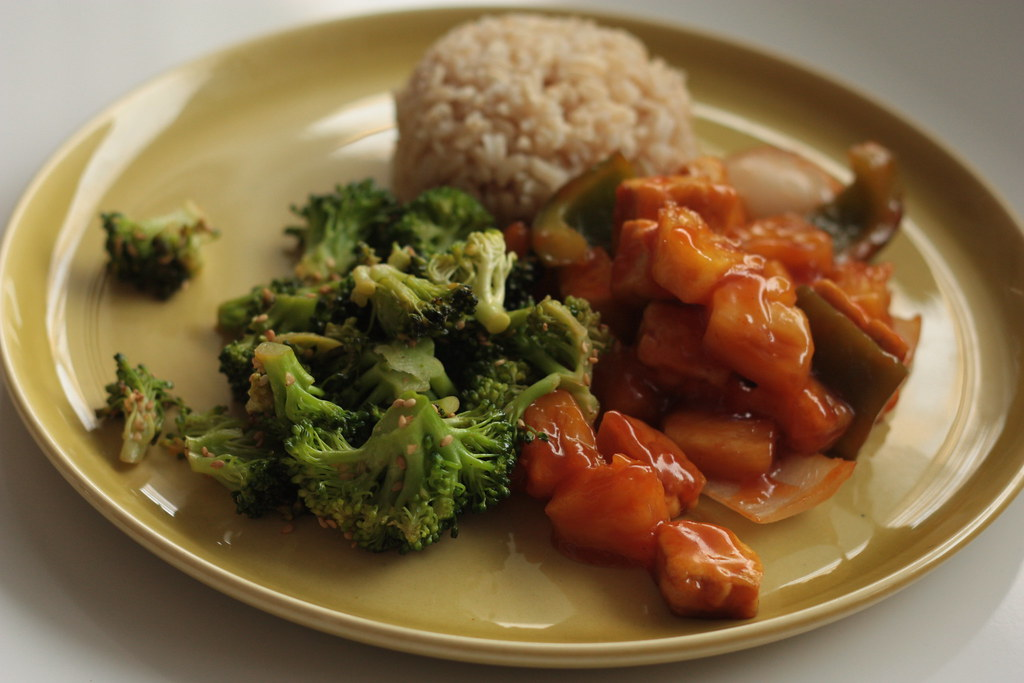 sweet and sour tofu, sesame broccoli, brown rice, by rooted vegan