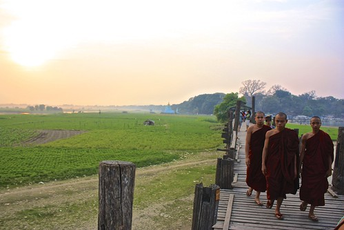 novice monks on the world's longest teak bridge