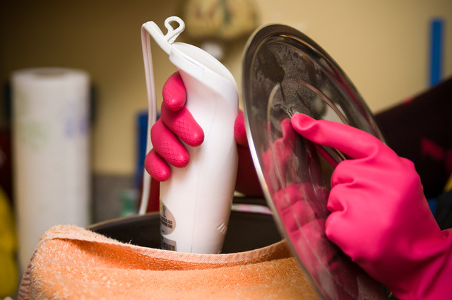Mixing soap with pretty pink gloves
