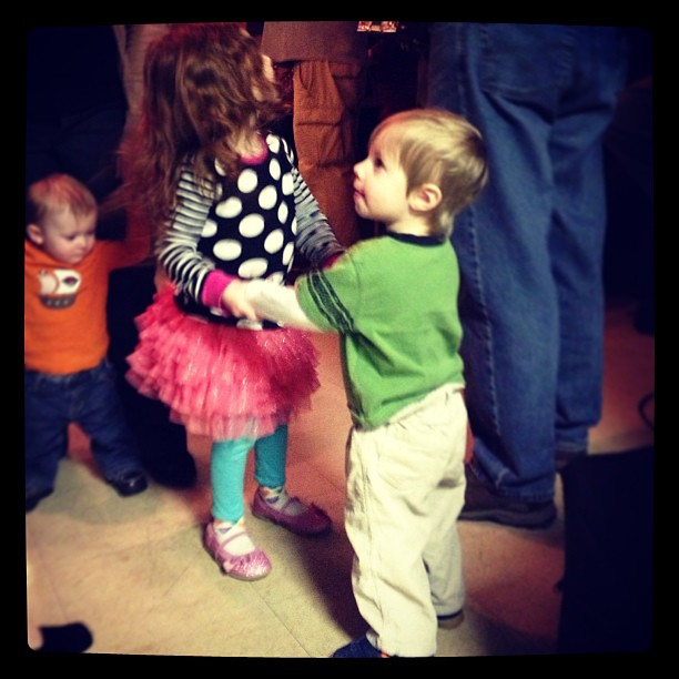 Siblings dancing together to a polka band at the Slovenian Fish Fry.