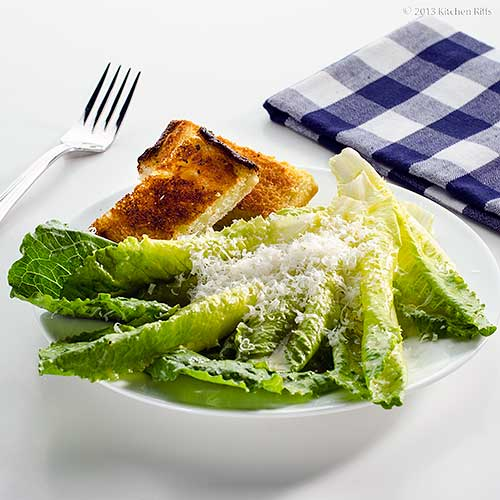 Caesar Salad on Plate with Garlic Bread