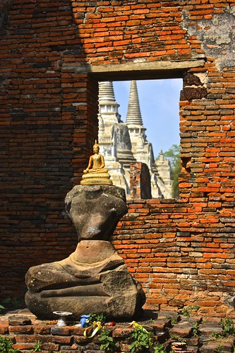 little Buddha on a Buddha ruin at Wat Phra Si Sanphet