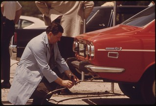 Inspector Testing The Exhaust Of An Auto At Soldier's Field One Of Nine Auto Pollution Test Sites Conducted Free By The City Of Chicago's Environmental Control Department, 08/1973