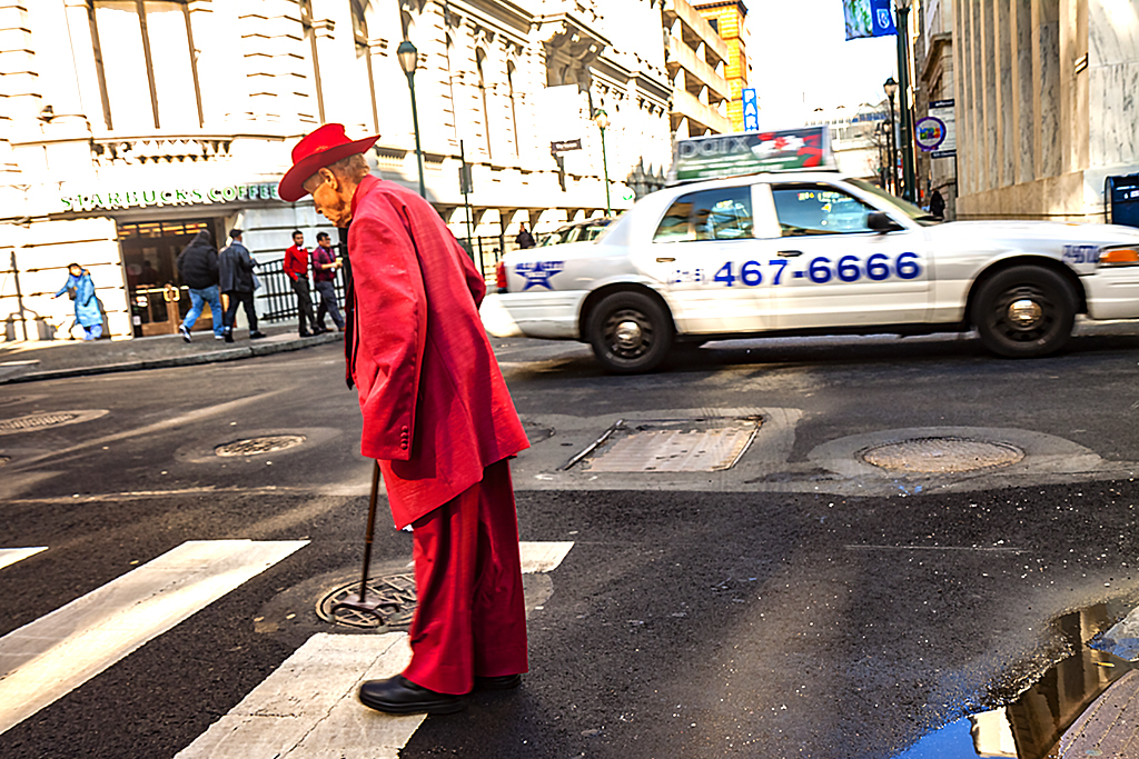 Man-in-red-suit-crossing-street--Center-City