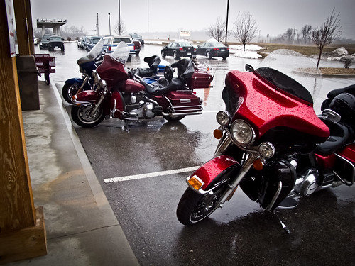 image of motorcycles parked in the rain