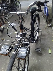 moped(0.0), electric bicycle(0.0), mountain bike(0.0), road bicycle(0.0), motorcycle(0.0), cyclo-cross bicycle(0.0), racing bicycle(0.0), wheel(1.0), vehicle(1.0), sports equipment(1.0), hybrid bicycle(1.0), land vehicle(1.0), bicycle(1.0), tarmac(1.0),
