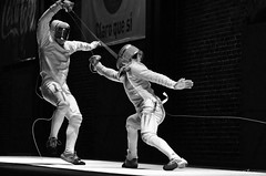 modern dance(0.0), choreography(0.0), weapon combat sports(1.0), fencing weapon(1.0), sports(1.0), performing arts(1.0), monochrome photography(1.0), ã‰pã©e(1.0), fencing(1.0), entertainment(1.0), foil(1.0), monochrome(1.0), black-and-white(1.0), performance art(1.0),